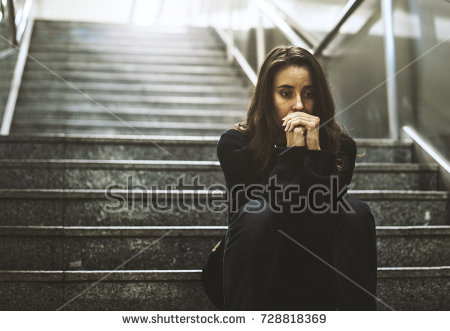 stock-photo-adult-woman-sitting-look-worried-on-the-stairway-728818369
